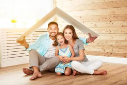 This happy couple and their daughter are protected by homeowners insurance