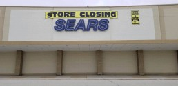 the outside of a sears store that is closing