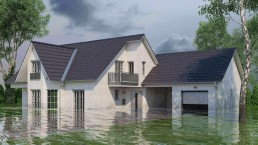 Water surrounding a white two-car garage home
