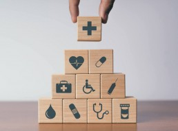 stack of blocks depicting health coverage