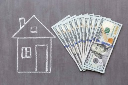 Chalk-drawn-home-with-money