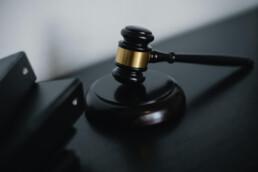 judge's gavel in hammering position