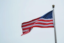 american flag waving from flag pole